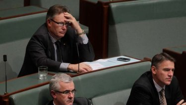 Independent MPs Tony Crook, top, Andrew Wilkie, left, and Rob Oakeshott at Parliament in Canberra.