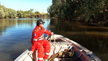 Hopeless: Rangers search for the body of Sean Cole who was taken by a crocodile on Mary River.