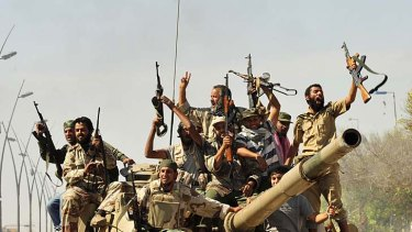 Jubilation .... anti-Gaddafi fighters celebrate the fall of Sirte.