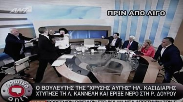 A screenshot shows Golden Dawn spokesman Ilias Kasidiaris, 2nd left,  strike Liana Kanelli, a female member of the Greek Communist party, during a talk show.