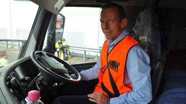 High visibility … Tony Abbott has taken to the streets to drive home his pledge to put the Pacific Highway before the Parramatta-Epping rail link.