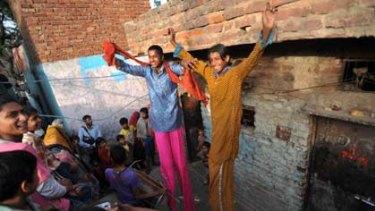 Tall tales ... Kathputli slum dwellers put on an impromptu performance, showcasing some of their special talents.
