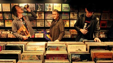 Record bar … Mojo owner Neville Sergent (centre) with Jon Ruttan and music fan Garth Sundberg.