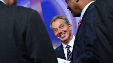 Tony Blair talks with the Reverend Jesse Jackson in New York.