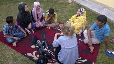 Shooting <i>Asylum</i>... Eva Orner with asylum seekers in Cisarua, Indonesia.