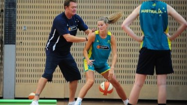 Call up: Retired Australian professional basketball player Luc Longley coaches Carley Mijovic of the Canberra Capitals.
