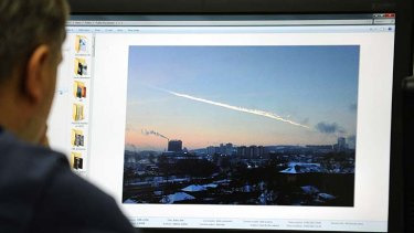 A Russian man watches the meteor.