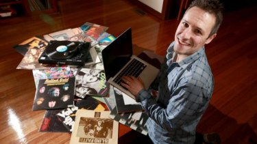 Retailer Bill McWilliams at home in Melbourne. McWilliams has started accepting the digital currency bitcoin as payment for vinyl records.