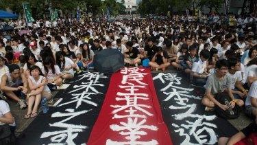 Students protest against Beijing's conservative framework for political reform in Hong Kong.