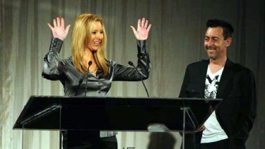 Alan Cumming presents the Webby Award for Outstanding Comedic Performance to Lisa Kudrow, for her role in Web Therapy, at the 13th Annual Webby Awards. She will collect another award this year.