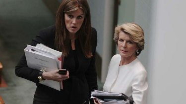 Debrief ... Peta Credlin, left, Tony Abbott's chief of staff, and Julie Bishop meet after Question Time.