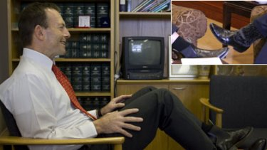 Political boot camp...Tony Abbott relaxes in his Manly office. Inset: Kevin Rudd and the environmental campaigner Al Gore show their styles during a visit by the latter to Sydney in July.