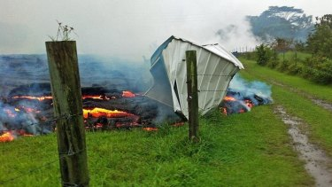 Gotcha: A small shed is consumed by the lava flow near Pahoa village on the Big Island.