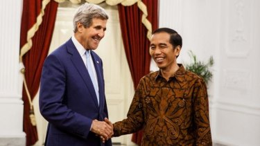 US Secretary of State John Kerry (left) meets Indonesian President Joko Widodo after a bilateral meeting at Presidential Palace.