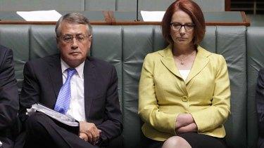 Storm coming: Treasurer Wayne Swan and Prime Minister Julia Gillard in Parliament on Monday.