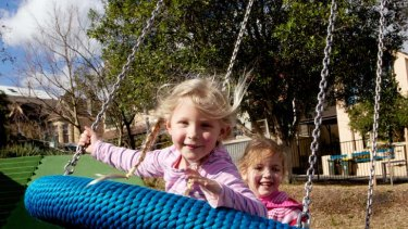 Close to home ... Lola Birley and Sophie Jollow, both 4, on the ''flying saucer'' at Constellation Playground.