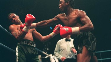 Benn throws a right at Gerald McClellan in their 1995 super-middleweight fight at the London Arena.