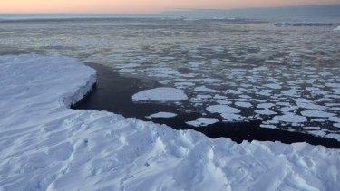 Melting icebergs ... a symptom of global warming.