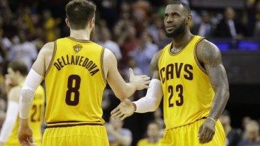 Cleveland Cavaliers forward LeBron James celebrates with teammate Matthew Dellavedova.
