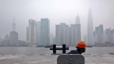 Is the great Chinese crash coming? ... a labourer works at a construction site in Shanghai.