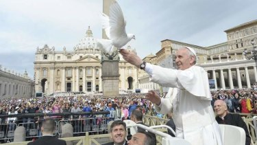 Gift of flight: Pope Francis frees a dove at the Vatican.