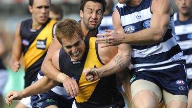 Not just good, but tough: Richmond's Daniel Jackson gets the Cats treatment.