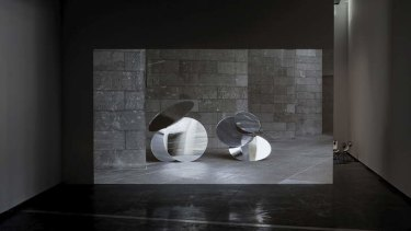 Linda Tegg's Tortoise is a video artwork incorporating Federation Court and dancers with reflective discs.