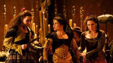Warm and sensuous ... the mezzo soprano Rinat Shaham as Carmen, centre, has a fiery demanding stage presence.