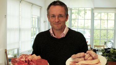 Michael Mosley in his home with a plate of red meat and processed red meat Michael Mosley: Should I Eat Meat? on SBS One. Image supplied by SBS publicity.