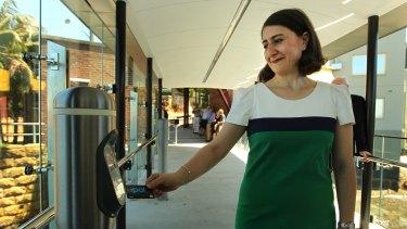 Fan: NSW Transport Minister Gladys Berejiklian taps on.