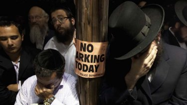 Death of an innocent ... men weep at the funeral of Leiby Kletzky. The murder suspect, Levi Aron, has been arrested.