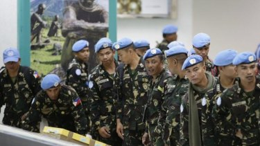 Pulled out: Philippine troops, who were deployed in the Golan Heights as UN peacekeepers, arrive home.
