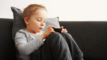 """Divided attention: When parents are with their children and on mobile devices, they're not always """"present"""" to their child's needs."""