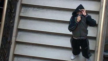 A man identified as Cherif Kouachi, one of the two brothers who killed 12 people in the attack on the weekly paper Charlie Hebdo, outside court in Paris in 2008.