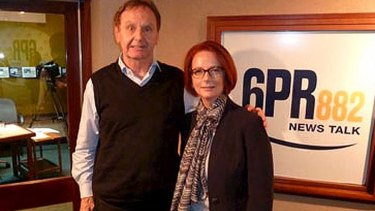 Stepping over the line: Howard Sattler poses with Julia Gillard after his bizarre interview on Thursday.