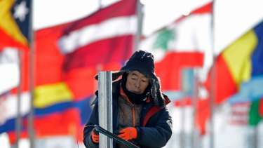 A worker helps set up venues at the PyeongChang Olympic Plaza. About 1200 private security staff have been removed due to a virus.