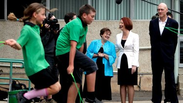 Green light for My School website launch: Julia Gillard and Peter Garrett speak to principal Jan Day at the Turner school in Canberra yesterday.
