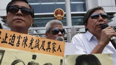 Rally for justice ... pro-democracy protesters in Hong Kong wear sunglasses as a gesture of support for the blind human rights advocate Chen Guangcheng.