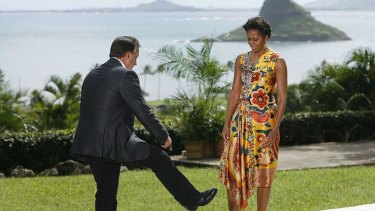 Tim Mathieson shows Michelle Obama his cowboy boots.