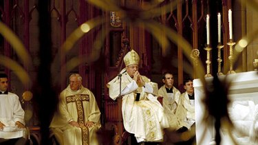 Cardinal George Pell at the washing of the feet service at St Marys Cathedral in Sydney on Thursday night. Picture: Dallas Kilponen