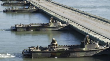 Bridge building boats in action during the war in Iraq.