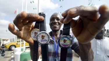 A vendor sells wrist watches with portraits of Nigerian President  Mohammadu Buhari in Abuja.