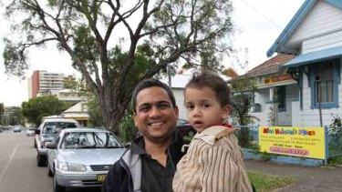 Rajesh Mudlapur with his son Sumedh, 2.