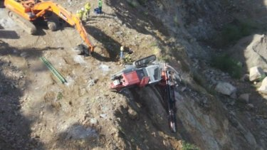 A driver was trapped in the 20-tone excavator.