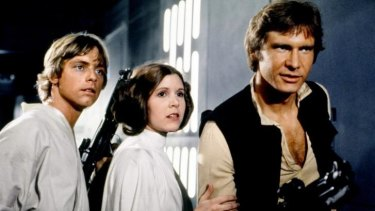 A still from the original Star Wars (1977) movie. Luke Skywalker (Mark Hamill),   Princess Leia (Carrie Fisher) and Han Solo (Harrison Ford) all return for The Force Awakens.