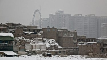 'Assimilation on steroids': Kashgar's old town (foreground) make's way for high-rises as part of China's policy to make the town a special economic zone.