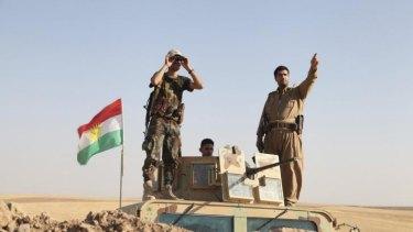 Kurdish peshmerga troops fight back against Islamic State militants.