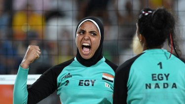 Doaa Elghobashy, of Egypt, celebrates during the women's beach volleyball pool match against Germany.