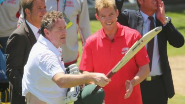 Piers Morgan salutes the crowd after facing deliveries from former Test cricketer Brett Lee.
