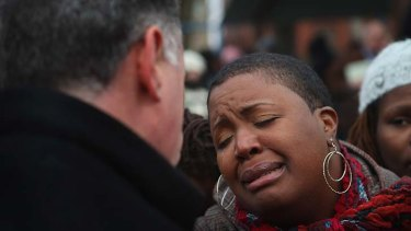 A mother's distress ... Superintendant Garry McCarthy comforts Hadiya's mother Cleopatra.